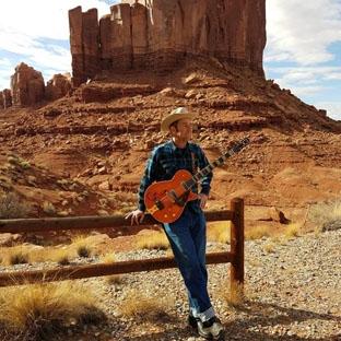 Plays Guitar-0